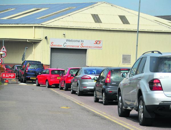 This Is Wiltshire: Motorists queue at Darby Close recycling centre