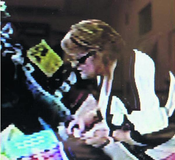This Is Wiltshire: Police want to speak to this woman after the theft of money from a cash machine in Trowbridge