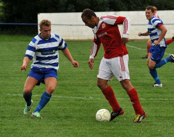 This Is Wiltshire: Shrivenham's Gio Wrona and Swindon Town's Josh Cooke in action