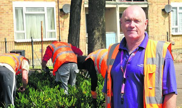 This Is Wiltshire: Community Payback Supervisor Doug Mack standing with offenders clearing the area around Sussex Square