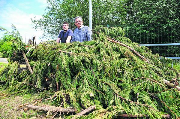 This Is Wiltshire: Neil Heavens and Derique Montaut, councillors for Liden and Eldene, with garden waste believed to have been fly-tipped outside Liden School