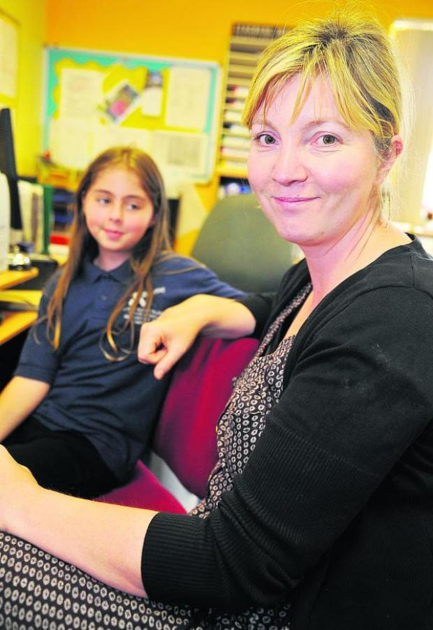 This Is Wiltshire: Andrea Honey with Anya at GWH's school