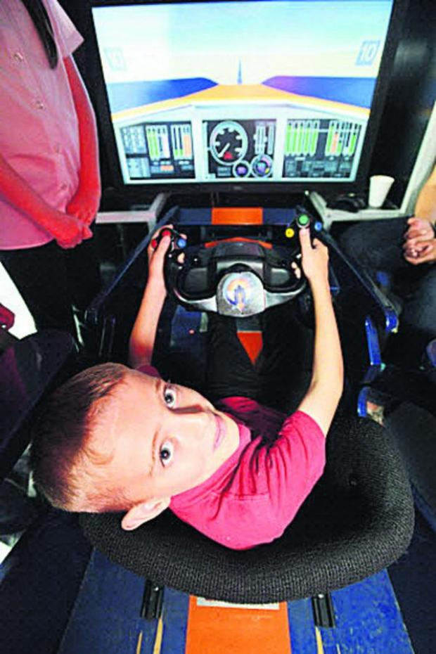 This Is Wiltshire: Lewis in the cockpit of Intel's Bloodhound at Churchfields Academy. Picture: THOMAS KELSEY