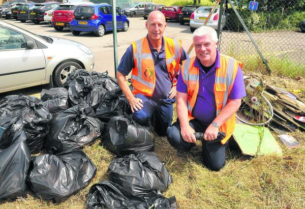 This Is Wiltshire: Dave Quarterman, left, and Dave Howlett next to rubbish they cleared on the footpath behind the Oasis Leisure Centre