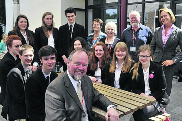 This Is Wiltshire: Sir Vincent Fean, front, former British Consul-General in Jerusalem and Ambassador in Libya, with St Augustine's Catholic College Sixth Form students, staff and members of Bradford on Avon Friends of Palestine group