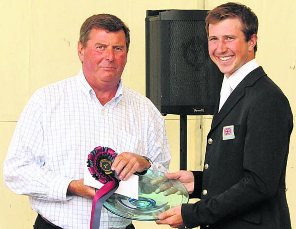 This Is Wiltshire: David Doel receives his CIC** prize from the Barbury Estate's Nigel Bunter