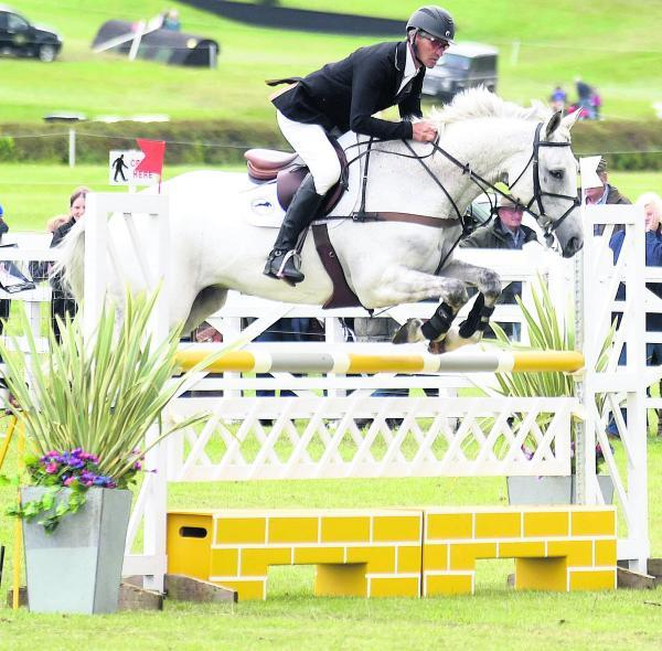This Is Wiltshire: CIC*** winners Andrew Nicholson and Avebury (above) complete the showjumping course (Picture: Diane Vose)