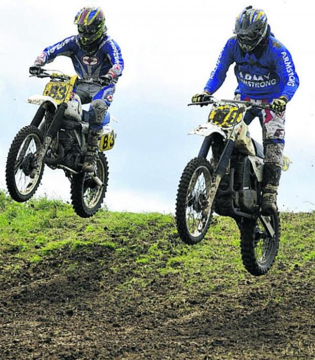 This Is Wiltshire: Ian Marks and Dave Hobbs take the jumps at the top of the course; above left, the Clubman 1 race gets underway on Sunday