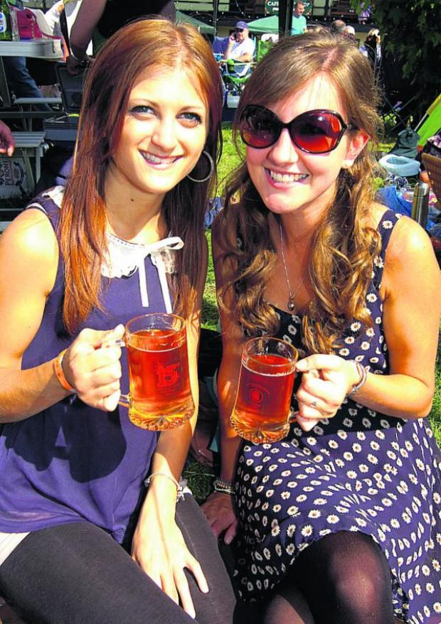 This Is Wiltshire: Jacqueline Hucker and Fiona Drewitt enjoy Devizes Beer Festival. Picture by Paul Morris
