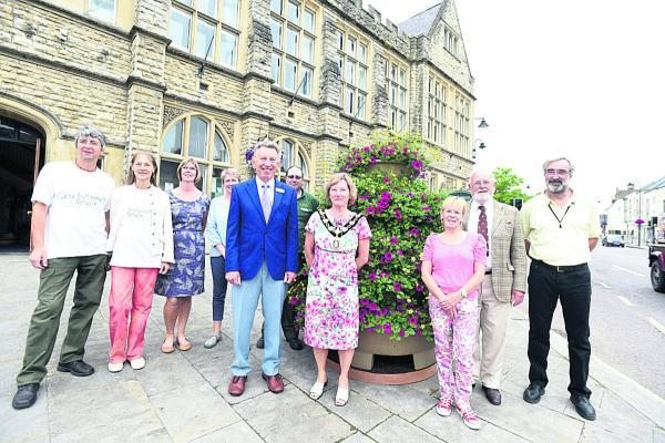 This Is Wiltshire: The judges and the Calne in Bloom Team join town mayor Heather Canfer outside the Town Hall
