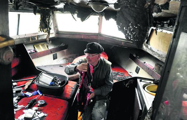 This Is Wiltshire: Lionel Gordon surveys the gutted interior of his boat. Picture by Siobhan Boyle