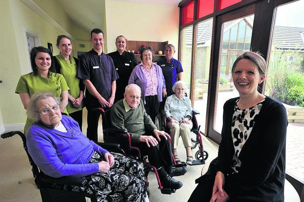 This Is Wiltshire: Jodie Llewllyn, right, with staff and residents
