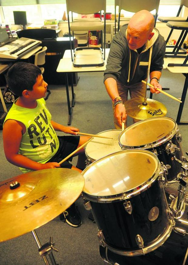 This Is Wiltshire: Andreas Juan is taught drumming by Martin Ranscombe