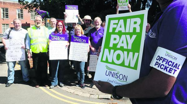 This Is Wiltshire: Council workers demonstrate outside Swindon's civic offices