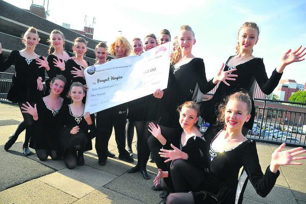 This Is Wiltshire: Tanwood School's fundraising chorus line with a grand £1,000 cheque for the 160 Appeal