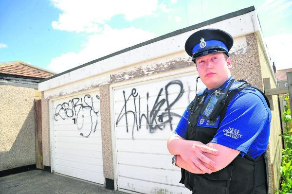 This Is Wiltshire: PCSO Andy Dellar with some of the new graffiti appearing  in Gorse Hill