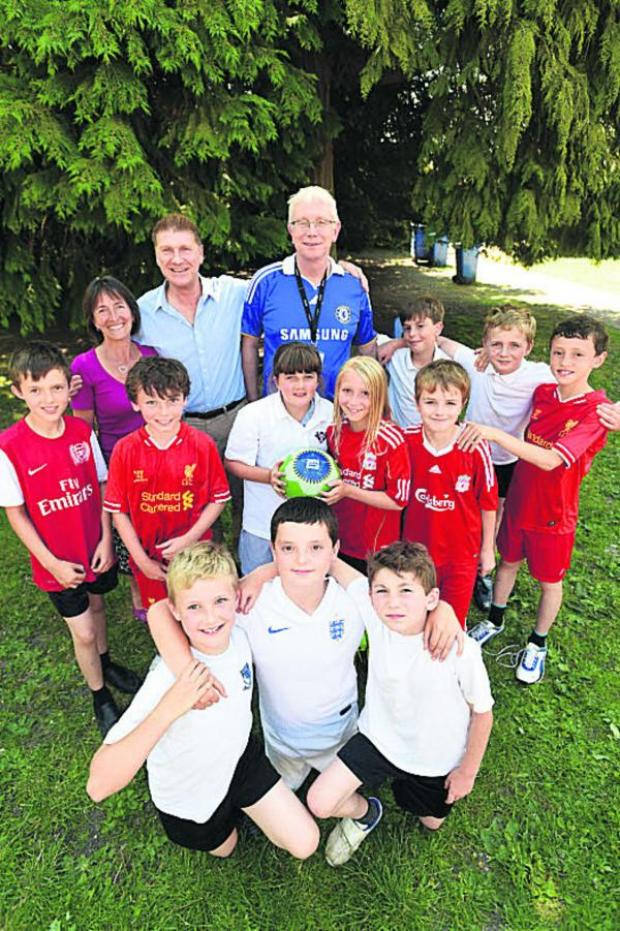 This Is Wiltshire: School governor Caroline Martin, Andy Trusler of Bag4Sport and headteacher Jonathan Barber with pupils taking part in the Premier League Reading Stars initiative. Picture by Diane Vose