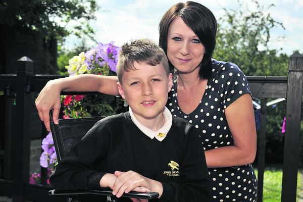 This Is Wiltshire: Ashley Gover and his mum Louise are delighted his sight has begun to improve