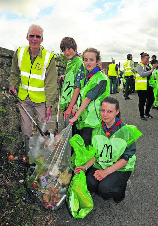 This Is Wiltshire: Bob Brice, leader of Trowbridge Town Council, with scouts Niall, Emma and Sophie clean up