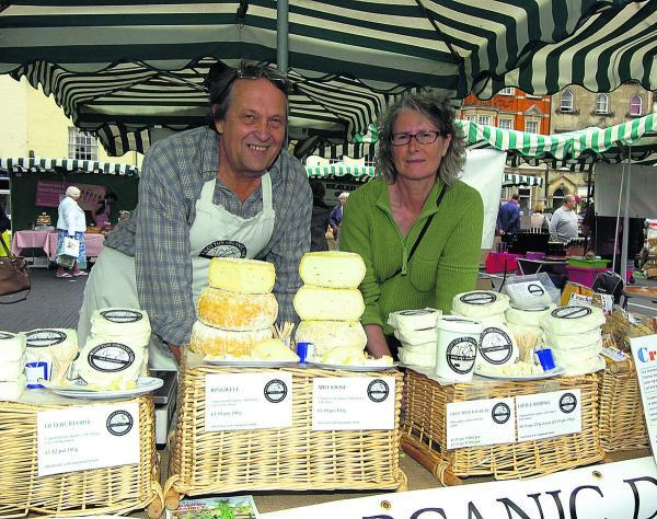 This Is Wiltshire: Sue Thomson with Jonny Williams on the cheese stall at the farmers' market. Picture by Paul Morris