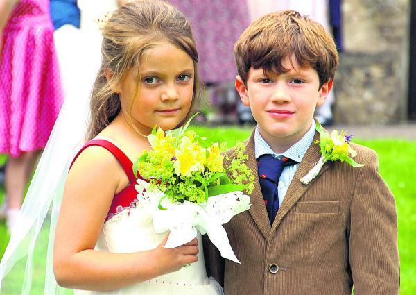 This Is Wiltshire: Bride Olivia Griffiths and groom Harry Pettitt at the Collingbourne Ducis School wedding                               (PM1351) By Paul Morris