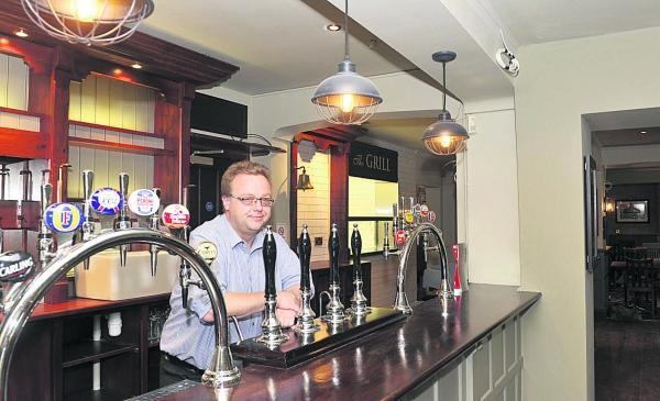 This Is Wiltshire: Licencee James Sawyer at the bar of the new-look Moonrakers pub. Picture by Siobhan Boyle