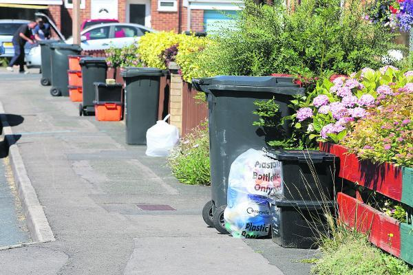 This Is Wiltshire: Bins in Moredon, which were not emptied yesterday  because of strike action