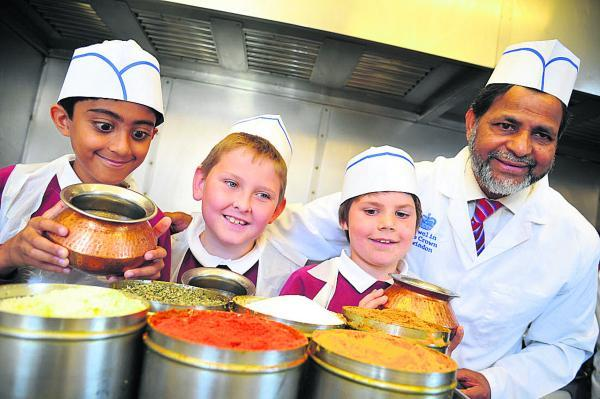 This Is Wiltshire: Currying favour with an array of spices are, left to right, Samee, Jay, Lucas and Muzammil Ali