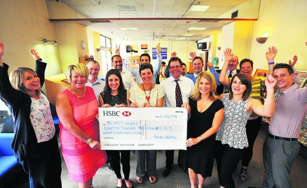 This Is Wiltshire: The Adver team hand over the cheque to Prospect chief executive Angela Jordan, centre