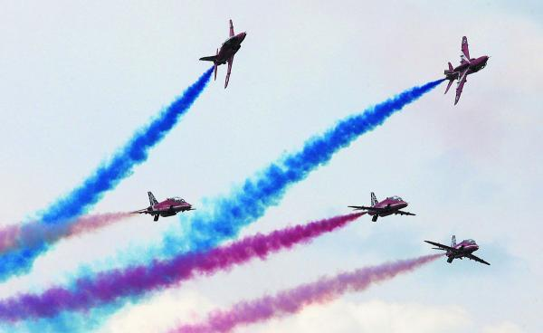 This Is Wiltshire: The Royal Air Force Red Arrows pictured during their routine