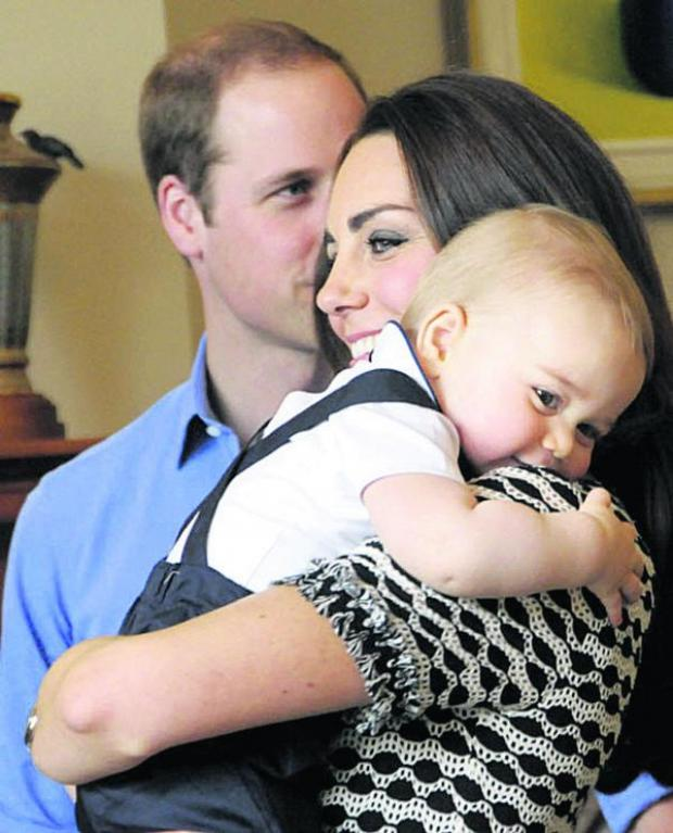 This Is Wiltshire: Prince George, whose first birthday is on July 22, with mum and dad the Duke and Duchess of Cambridge