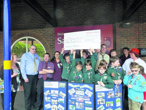 This Is Wiltshire: Members of the 6th Devizes Scout Group pick up the proceeds of fundraising at Sainsbury's