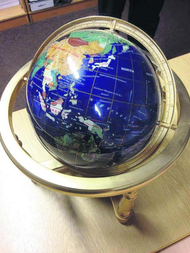 This Is Wiltshire: The expensive globe which was left outside someone's front door in Royal Wootton Bassett over the weekend
