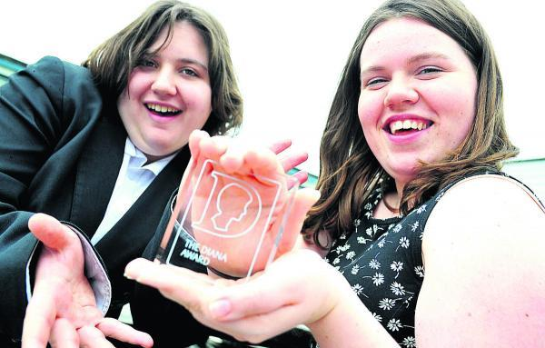 This Is Wiltshire: Rhiannon Davies, right, and Olivia Tuck from Pit Stop Ridgeway school have received a Diana Award for an anti-bullying campaign . They both went to London to receive their award