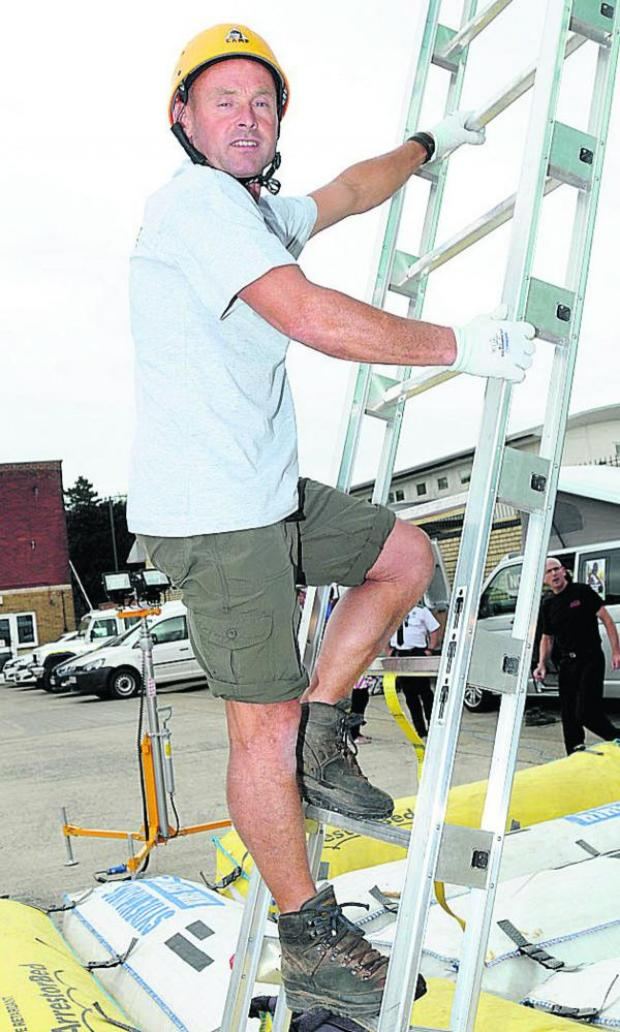 This Is Wiltshire: Warminster roofer Keith Saunders smashes world record for ladder climbing at Salisbury Fire Station