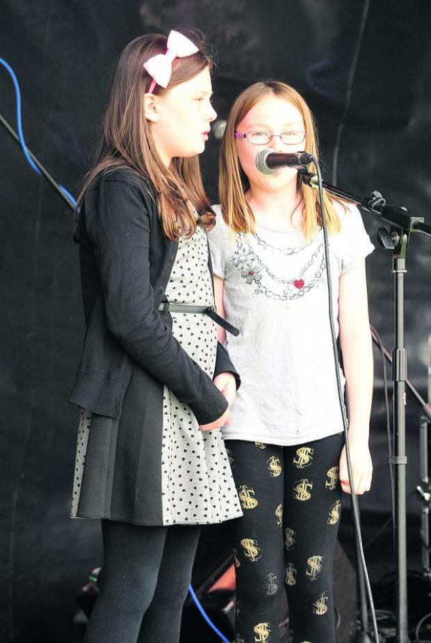 This Is Wiltshire: Maddie and Libby in good voice as they take part in the talent competition at Vic Fest. Picture by Vicky Scipio