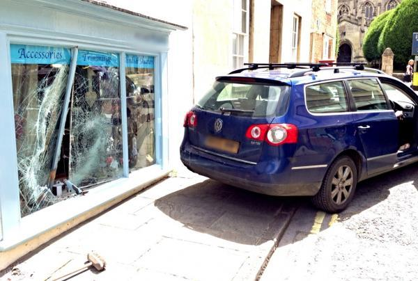 This Is Wiltshire: The blue Volkswagen estate which rolled down Church Street, Calne, and hit a shop window