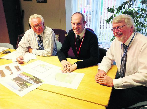This Is Wiltshire: From left, Warneford School governor Malcolm Holbrook, MP Justin Tomlinson and headteacher  John Saunders looking at the plans for the new sports centre