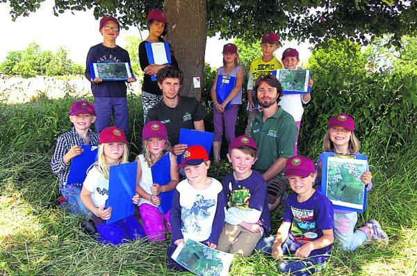 This Is Wiltshire: Ed Plant and Alex Brown from Oxenwood show Rushall school children map reading