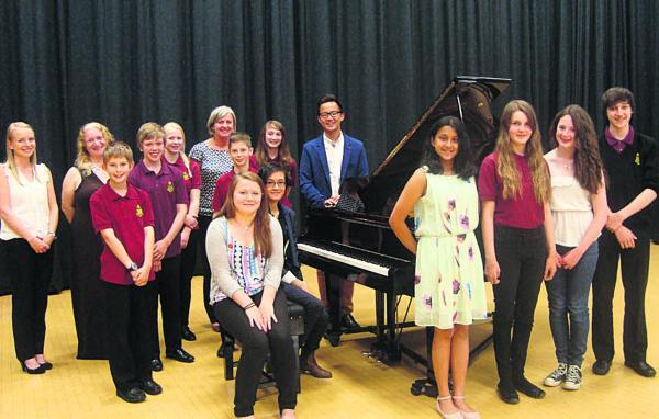 This Is Wiltshire: Pianists at Royal Wootton Bassett Academy with the new grand piano