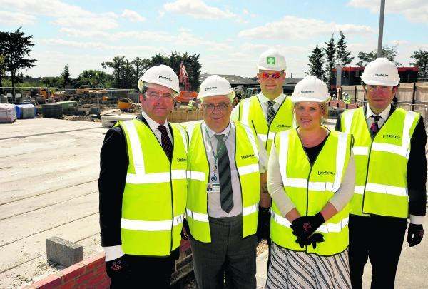 This Is Wiltshire: Work has begun on the new affordable extra care housing scheme in Cloatley Crescent, Royal Wootton Bassett. From left, locality manager Paul Tewkesbury, Coun Keith Humpheys, contract manager Matt Sidwell, Victoria Smith of Wiltshire Council and property d