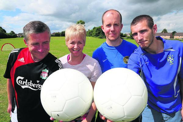 This Is Wiltshire: Members of Threshold in Swindon playing football to help them with confidence development. From left, Jason le Feuvre, positive activity worker Donna Harris, Tim Hall from Wiltshire F/A and Matthew Swann