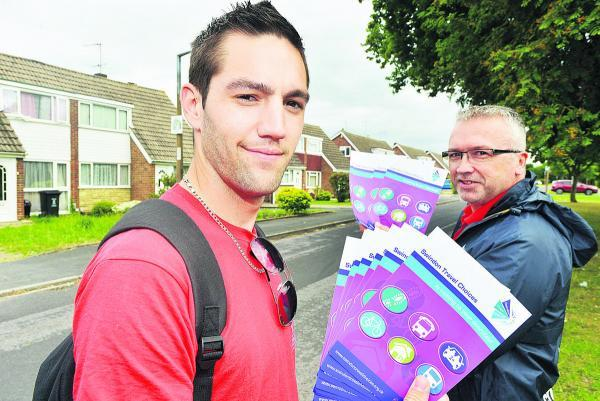 This Is Wiltshire: Travel Choices staff Quentin Gaullier and Marcus Walker-Loveridge hand out leaflets