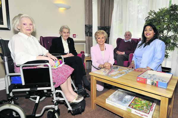 This Is Wiltshire: Former BBC newsreader Angela Rippon chats to residents, from left, Dorothy Gasson, Thelma Curtis and Trevor Ralphs with manager Selvie Naidoo