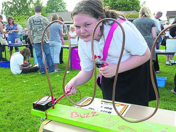 This Is Wiltshire: Rebecca on the buzz wire at Westbury Junior School's fete