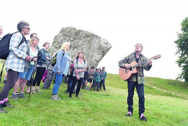 This Is Wiltshire: Walkers set off at 9.30am, with musician and event founder Nick Harper leading the way, right
