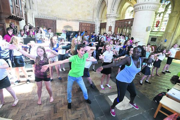 This Is Wiltshire: Pupils from Malmesbury area schools rehearse with the Bristol-based AMJ collective at Malmesbury Abbey  (DV1456) BY DIANE VOSE