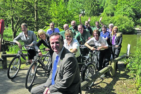 This Is Wiltshire: Long-serving staff at Centre Parcs Longleat Forest with general manager Andy De'Ath