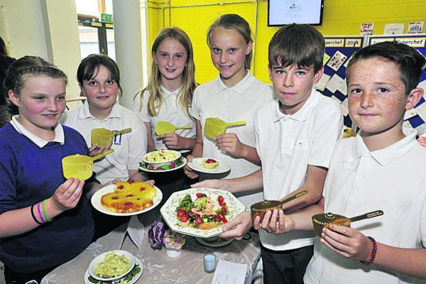 This Is Wiltshire: Winners of the masterchef contest Leah Webb and Melissa Gould, centre, from Forest and Sandridge Primary School, with runners up Ella Miles and Elle Snell from Manor Primary School and Callum McMillan and Oliver Spooner from Bowerhill Primary