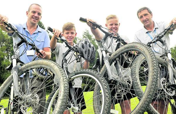 This Is Wiltshire: Pupils and staff from Downlands School in Devizes are taking part in  a national bike challenge riding through the Alps. From left are staff member Mike Rees-Lee, pupils Bailey Spall and Marley North and staff member Tommy Callinan